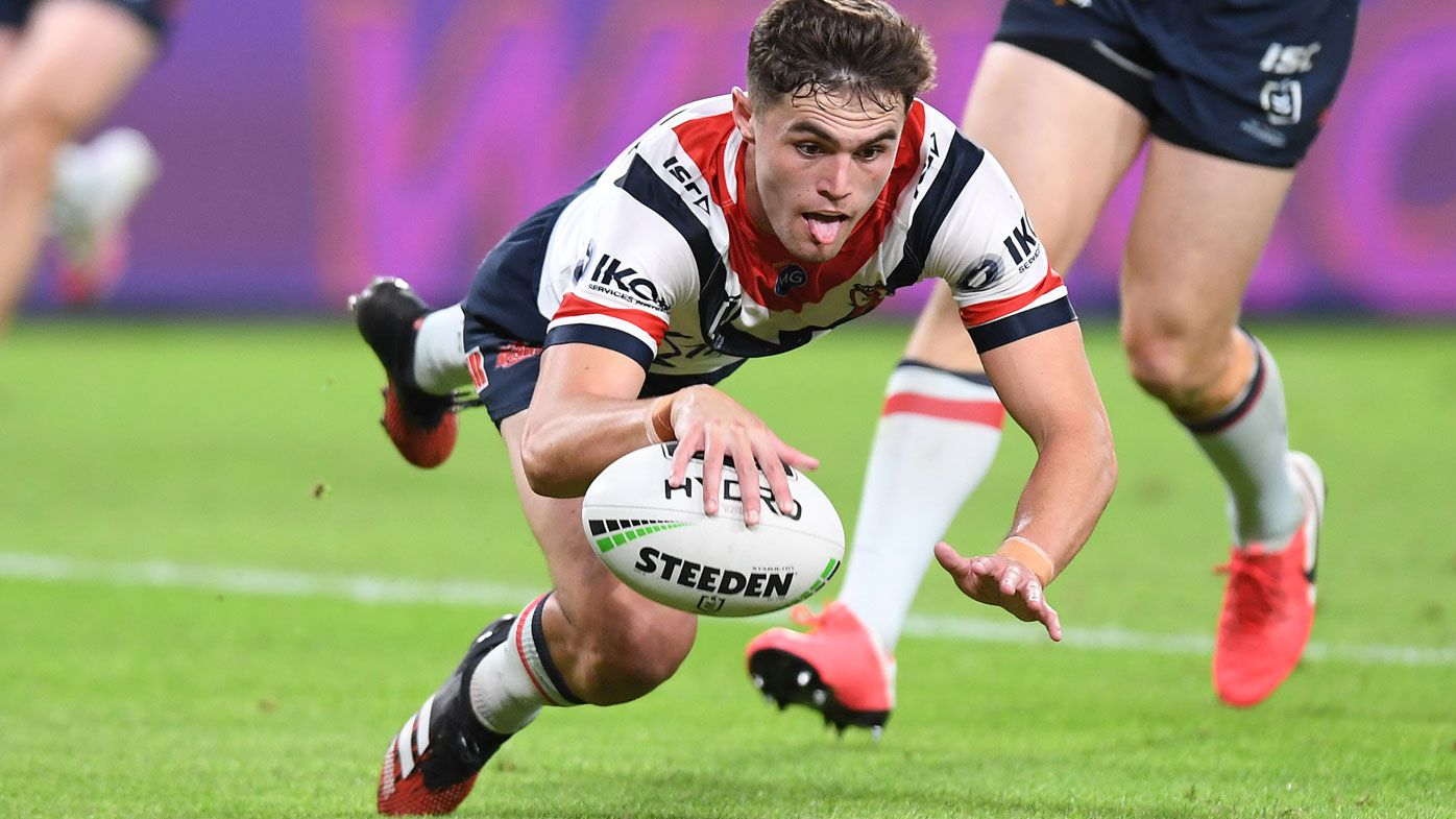 Kyle Flanagan of the Roosters scores a try during the round four NRL match between the Brisbane Broncos and the Sydney Roosters at Suncorp Stadium on June 04, 2020 in Brisbane, Australia.