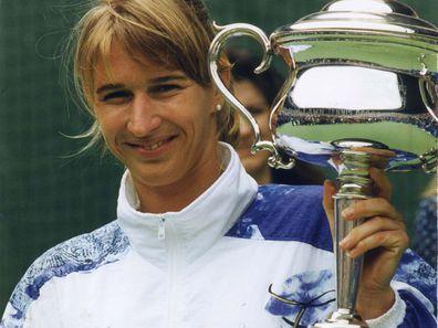 Steffi Graf holding the Australian Open Cup