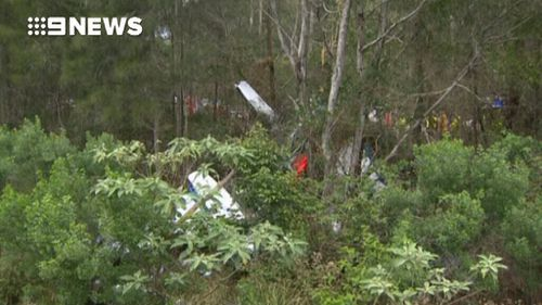 The plane crashed just metres from the road and a railway line. (9NEWS)