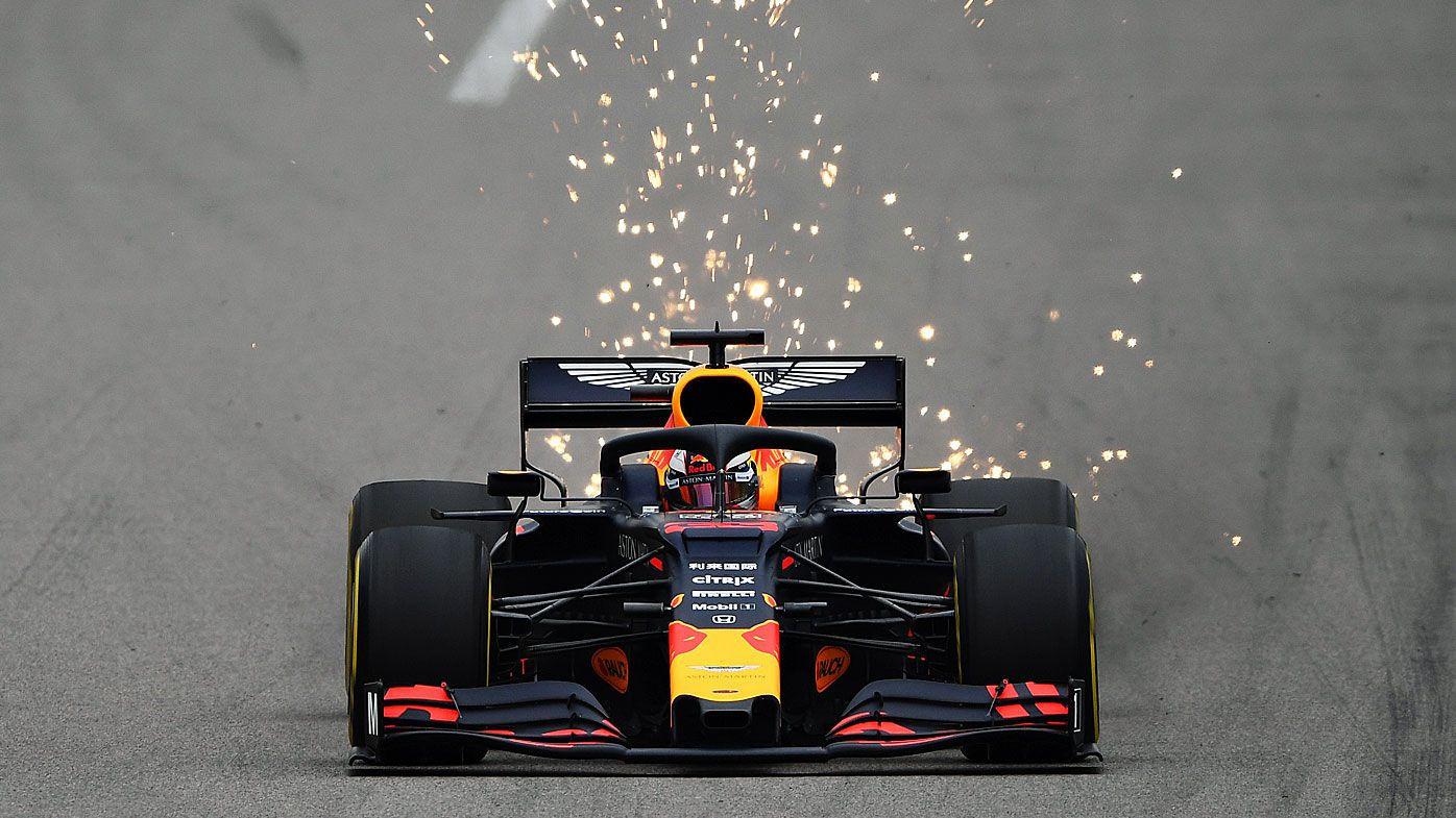 Sparks fly behind Verstappen's car
