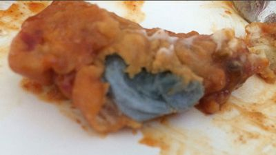 Other things besides animals can occasionally creep into foods as this deep fried paper towel in a piece of chicken demonstrates.