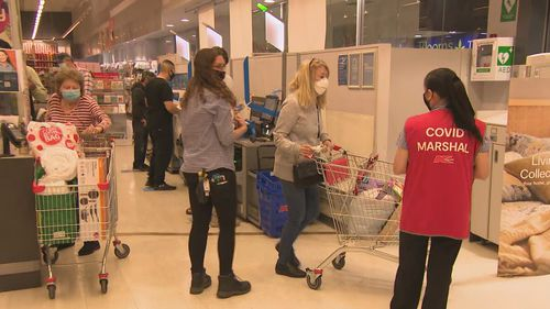 COVID-19 marshalls were on hand in Kmart to ensure everybody was sticking to the rules.
