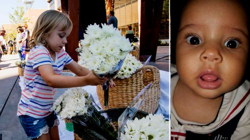 Floral tributes to Ruya Kadir stabbed to death at her third birthday party in Idaho. (Photos: AP).
