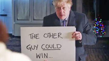 British Prime Minister Boris Johnson holds up a placard in his Love Actually election video.