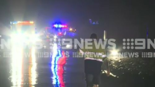 Three people were rescued from two cars in the Hervey Bay region last night. (9NEWS)