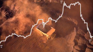 An iron ore truck stirs up the dirt as it drives through Eastern Ridge mine (Ethel Gorge) in Newman, Western Australia.