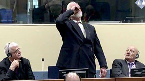 Slobodan Praljak brings a bottle to his lips, during a Yugoslav War Crimes Tribunal in The Hague, Netherlands. (AAP)