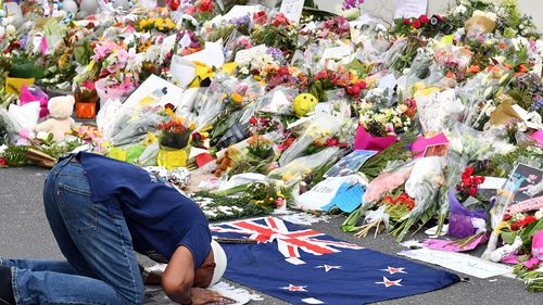 A muslim worshipper prays at a makeshift memorial at the Al Noor Mosque on Deans Rd in Christchurch, New Zealand.