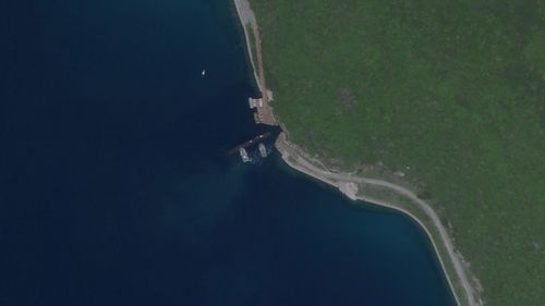 A satellite image from Aug. 18, 2020, appears to show a Chinese submarine using an underground base on Hainan Island on the South China Sea.