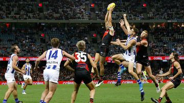 Kyle Langford of the Bombers marks the ball during the round 10 AFL match between the Essendon Bombers and the North Melbourne Kangaroos at Marvel Stadium.