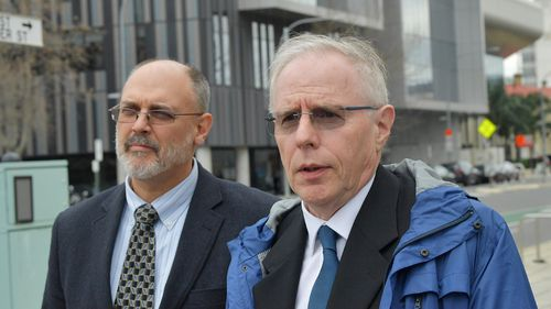 Dr Jim Buckley (right) from The Royal Adelaide Hospital departs after giving evidence at the inquest. (AAP)