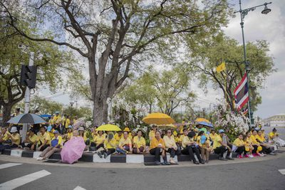 The people of Thailand gathered outside the Royal Palace, to wait for the coronation ceremony of the King Rama X, in Bangkok, Thailand, over the weekend.