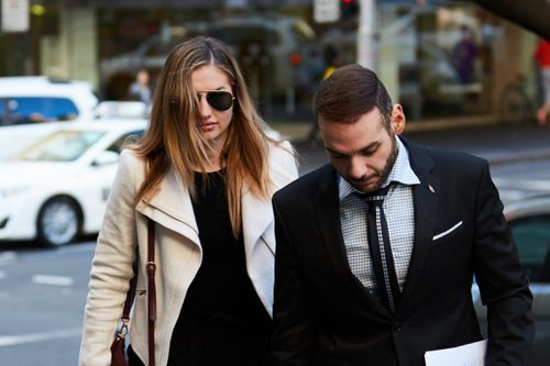 Eagle was flanked by her legal tea as she entered court. Picture: AAP