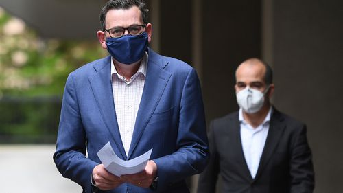 Victorian Premier Daniel Andrews enters the press conference wearing a face mask on July 20, 2020 in Melbourne, Australia.