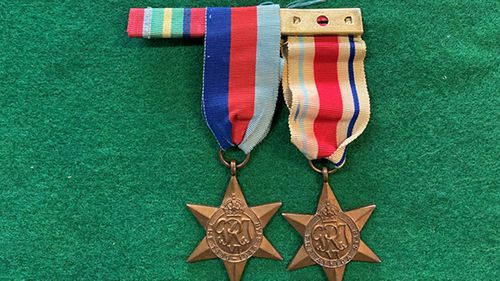 The medals were stolen from Downs' home in 1969.
