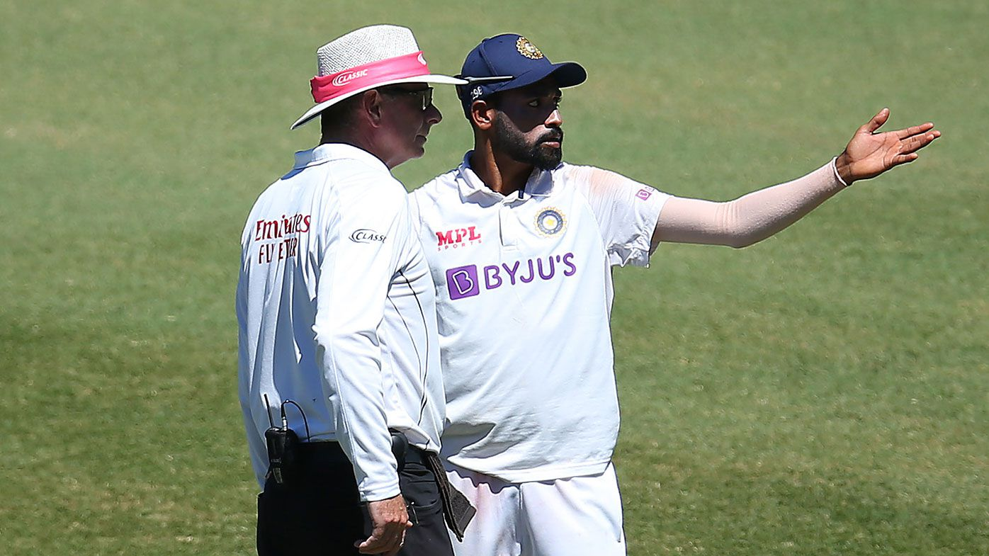 Mohammed Siraj of India speaks to Umpire Paul Reiffel d