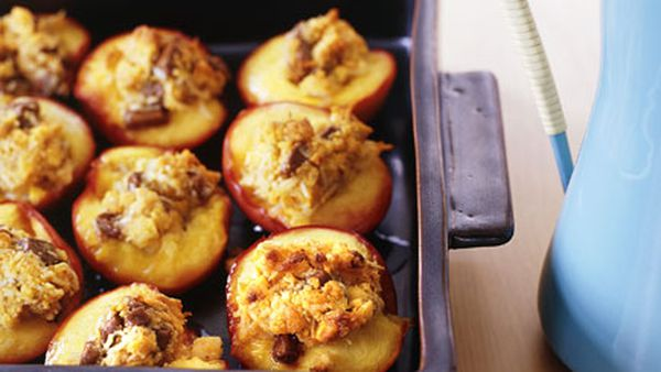 Baked nectarines stuffed with coconut and milk chocolate