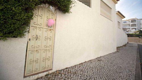 A pink balloon outside apartment 5A on Rua Dr Agostinho da Silva in Praia Da Luz, Portugal, where Madeline McCann went missing.