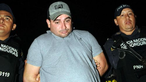 Police escort Plutarco Antonio Ruiz, the boyfriend of Miss Honduras Maria Jose Alvarado's sister. (Getty)