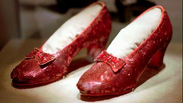 A file photo shows one of the four pairs of ruby slippers worn by Judy Garland in the 1939 film The Wizard of Oz.