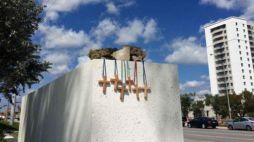 Six wooden crosses represent the victims of the Florida bridge disaster. (Photo: AP).