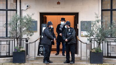 Police officers are seen outside the King Edward VII hospital where Prince Philip, Duke of Edinburgh is currently receiving treatment on February 18, 2021 in London, England