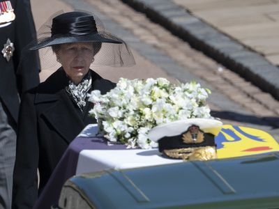 Princess Anne walks as the only woman in the procession