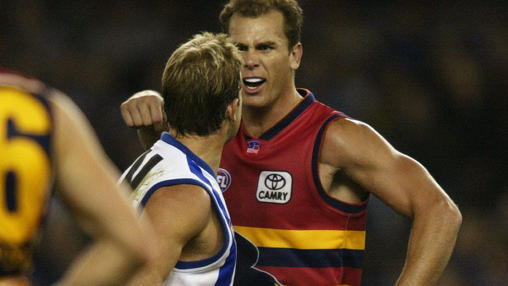 Glenn Archer (left) and Wayne Carey. (Getty)