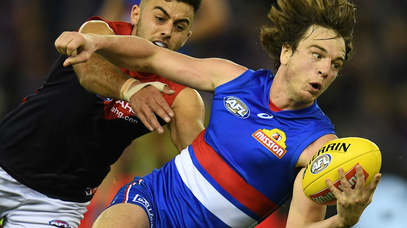 Christian Salem of the Demons (left) and Liam Picken of the Bulldogs contest during the Round 13 AFL match between the Western Bulldogs and the Melbourne Demons at Etihad Stadium in Melbourne, Sunday, June 18, 2017