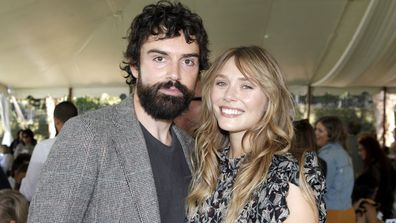 Robbie Arnett and Elizabeth Olsen attend the Rape Foundation Annual Brunch 2019 at a Beverly Hills Private Estate on October 06, 2019 in Beverly Hills, California.