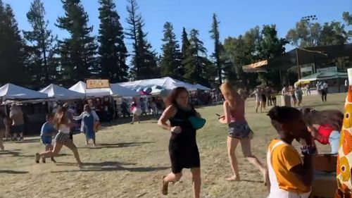 Scenes purportedly showing people fleeing a shooter at California's Gilroy Garlic Festival. Image courtesy: Twitter wavyia