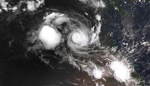 Cyclone Owen is rapidly gathering strength over the warm waters of the Gulf of Carpentaria with forecasters still expecting it to cross the coast on Friday.