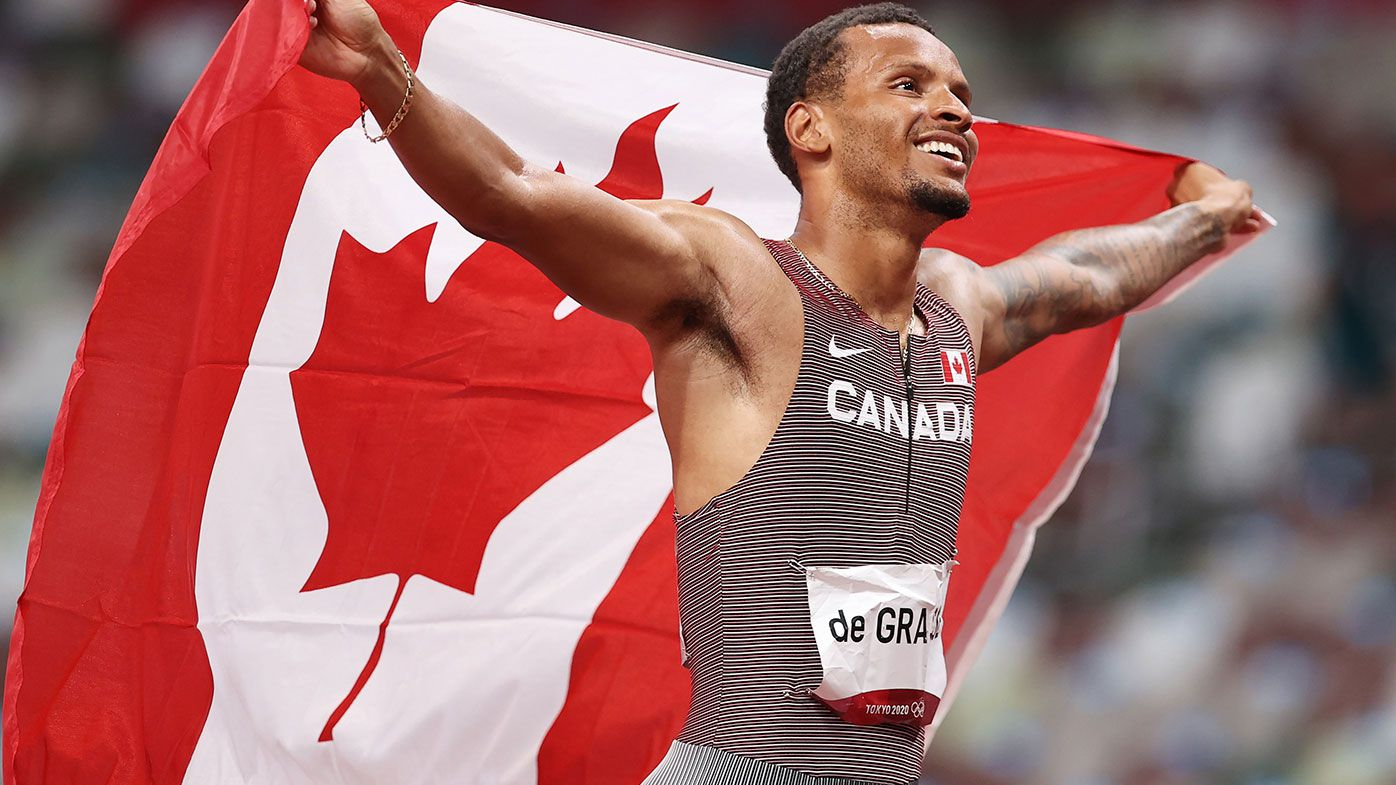 Andre De Grasse of Team Canada celebrates after winning the gold medal in the Men's 200m Final on day twelve of the Tokyo Olympic Games.