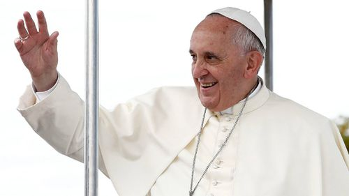 Pope Francis turns Santa with Christmas giveaway for homeless