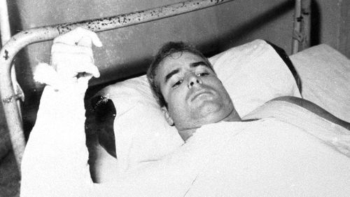 John S. McCain, USN, is shown in this undated photo lying injured in North Vietnam wearing an arm cast. He was a held prisoner during the Vietnam War.