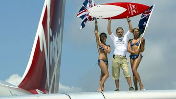 Richard Branson, Chairman of Virgin Atlantic Airways pictured arriving at Sydney International Airport with the first Virgin Atlantic flight to Australia, in 2004.