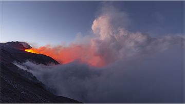 Italy's Mount Etna has erupted, sending plumes of lava and ash into the sky.