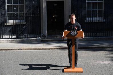 Theresa May hot podium guy