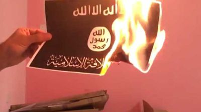 """The minister, Ashraf Rifi vowed to""""bring to justice those individuals who burned the ISIS flag in Sassine Square""""."""