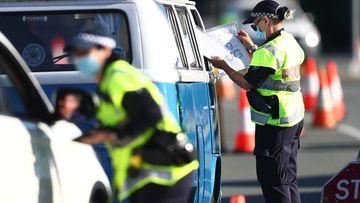 Queensland Police stop vehicles on the Queensland-NSW border in Coolangatta,