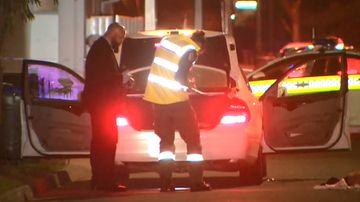 Adelaide police investigate the car where a woman was found dead next to an injured man.