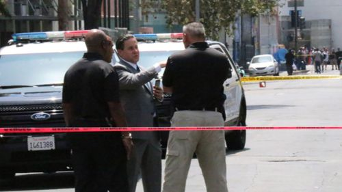 Police are searching for a shooter after four people were injured in Los Angeles.