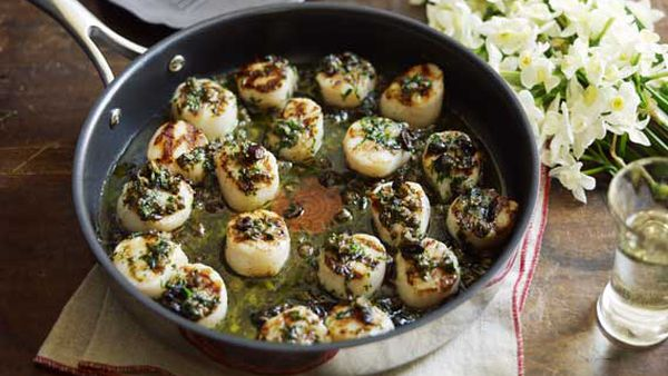 Grilled scallops with lemon, olive, caper and parsley butter