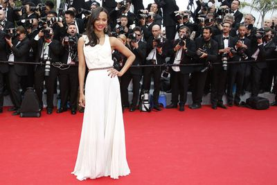 The usually edgy dresser takes it down a notch for Cannes in this simple white Victoria Beckham gown with fine pleat detailing.