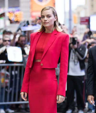 Margot Robbie knows how to make an entrance. She's wearing head to toe Versace. As you do.