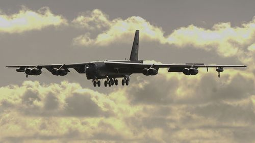 A US B-52 bomber flew near contested islands in the South China Sea.