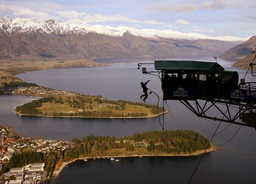 A person flings them self over the edge of an AJ Hackett Bungy jump over Queenstown, in New Zealand's South Island.