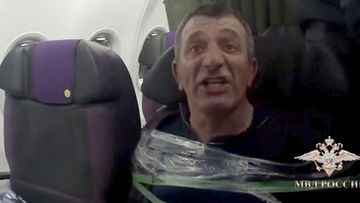 A man was taped to his seat mid-flight.