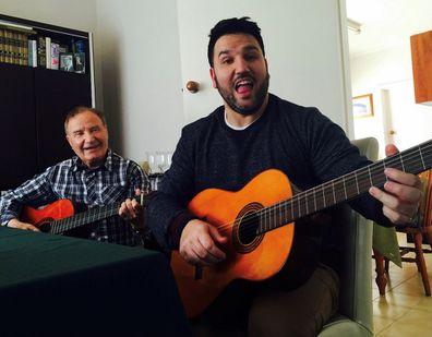 Sooshi Mango with his dad guitar