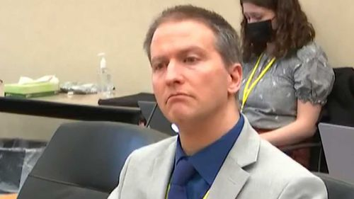 Former Minneapolis police Officer Derek Chauvin listens as his defence attorney Eric Nelson gives closing arguments.